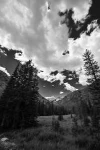 Summer clouds spill across the sky above the trail that follows the west fork of Rock Creek near Red Lodge, Montana.