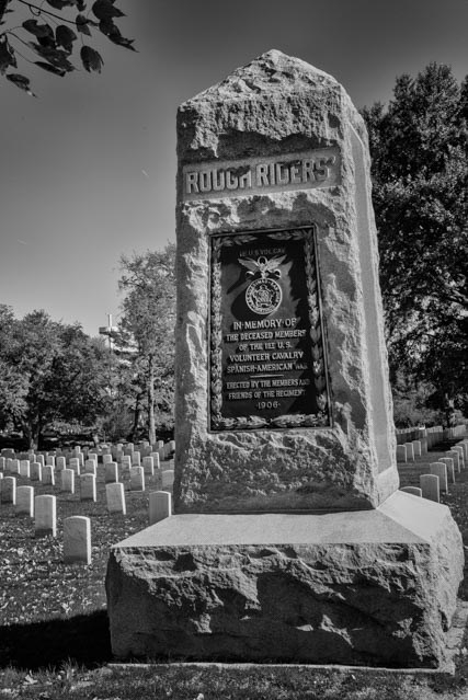 """A memorial dedicated in 1907 that commemorates those members of the """"Rough Riders"""" who died in the Spanish–American War in 1898. The Rough Riders were a Calgary unit formed by Teddy Roosevelt. They were nicknamed by the press the """"Rough Riders"""" because most of the men were cowboys, frontiersmen, railroad workers, Native Americans, and similar """"rough"""" people from the West."""